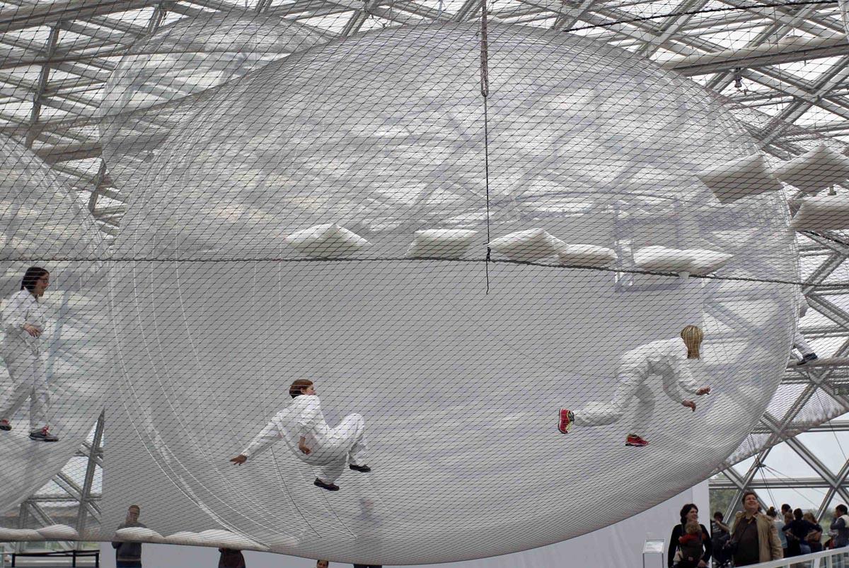 Visitors climb through installation 'in Orbit' by artist Saraceno in Duesseldorf