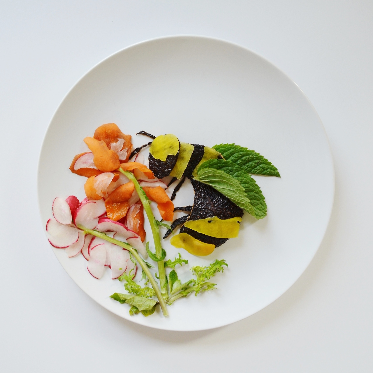 Artist promotes healthy eating through food art lost in for Artistic cuisine menu